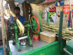 Pressing sugar canes to make juice!